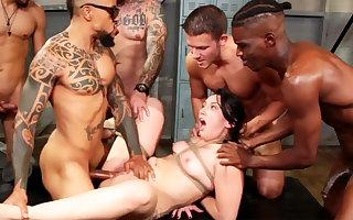 Bound brunette enjoys her very first interracial gang-bang
