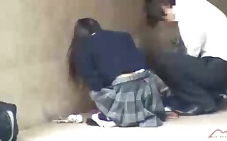 Dark haired, Chinese student is getting humped in a public place, in the middle of the day